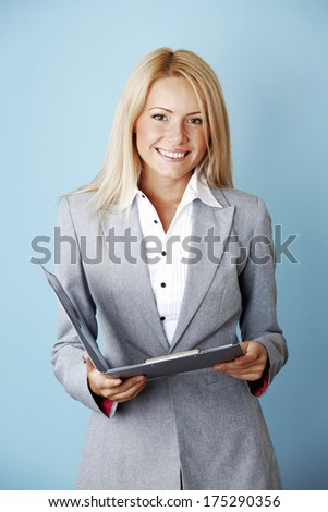 Young beautiful business woman with folder - stock photo
