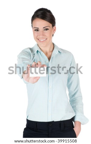Young, beautiful businesswoman holding out blank business card, happy and smiling, isolated on white background; focus is on the woman - stock photo