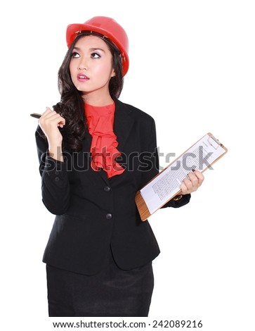 young beautiful businesswoman in builder helmet with building plan isolated on white background - stock photo