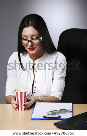 Young beautiful businesswoman is relaxing at office. - stock photo