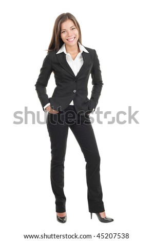 Young beautiful businesswoman isolated. Stylish mixed caucasian / chinese model in suit isolated in full length on white background. - stock photo