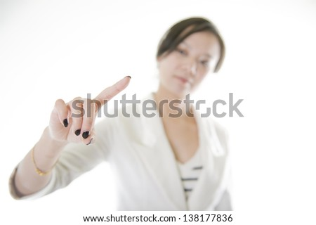 Young beautiful businesswoman pointing something