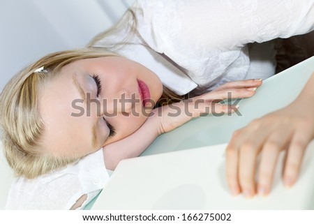 Young Beautiful Businesswoman sleeping at work desk