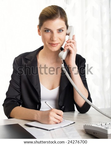 young beautiful businesswoman speaking on the telephone - stock photo