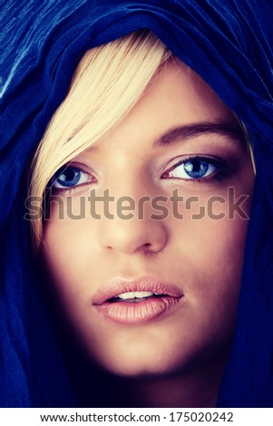 Young beautiful caucasian blond woman face with blue eyes - stock photo