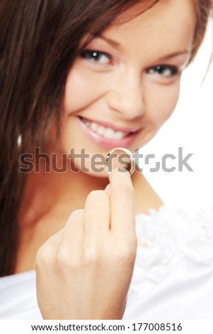 Young beautiful caucasian bride over white background