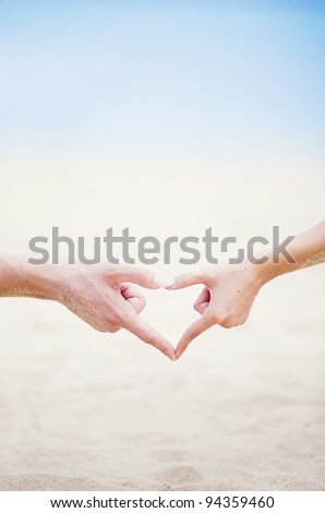 Young beautiful caucasian couple on the beach - stock photo