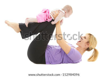 young beautiful caucasian mother holding her baby daughter doing baby yoga - stock photo