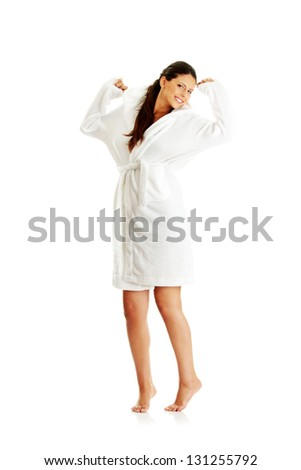 Young beautiful caucasian woman after bath full portrait isolated on white