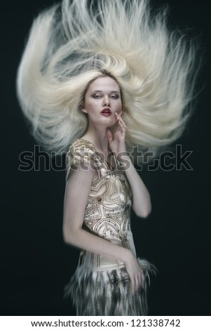 young beautiful caucasian woman in gorgeous dress, motion shot - stock photo