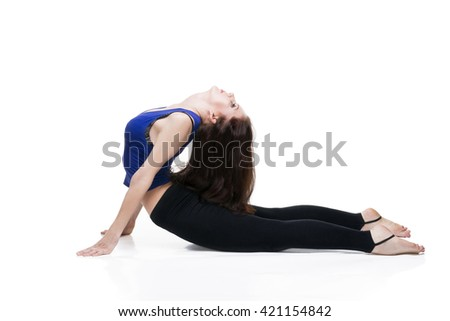Young beautiful caucasian woman in yoga pose isolated on white background. Sexy female body