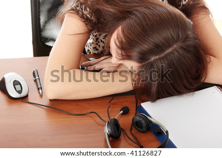 Young beautiful caucasian woman sleeping in call center work - stock photo