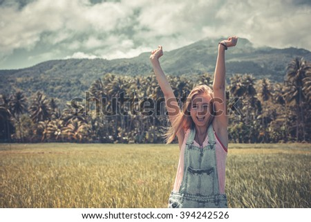 Young beautiful caucasian woman with blonde long hair smiling or laughing with her hands up. Happy funny woman. Happiness or success concept. - stock photo