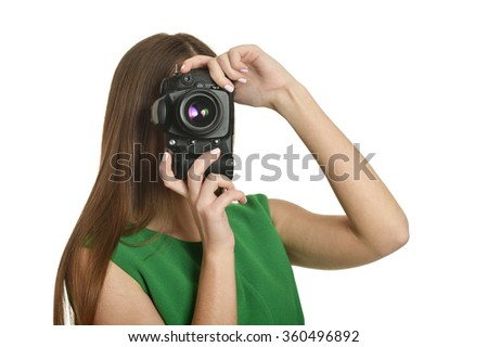 Young beautiful caucasian woman with camera over white backgroun - stock photo