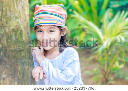 young beautiful child girl in traditional clothes on natural background, Philippines, Malay, Panay - stock photo