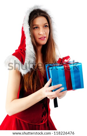 young beautiful Christmas woman with present, Focus on gift - stock photo