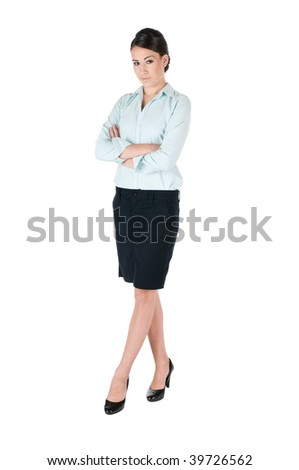 Young, beautiful, confident businesswoman, standing up with arms and legs crossed, isolated on white background - stock photo
