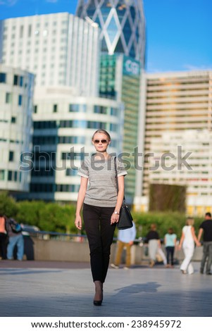 Young beautiful confident woman in business district of Paris