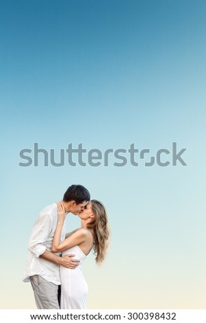 Young beautiful couple at tropical sea beach - stock photo