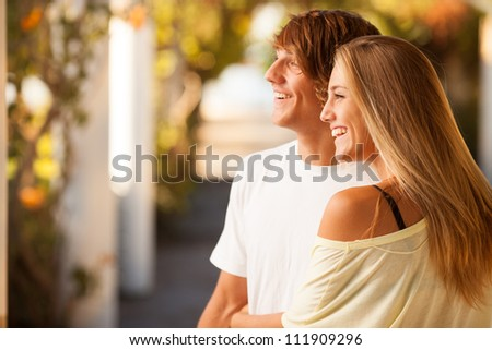 young beautiful couple enjoying a day on the park on summer