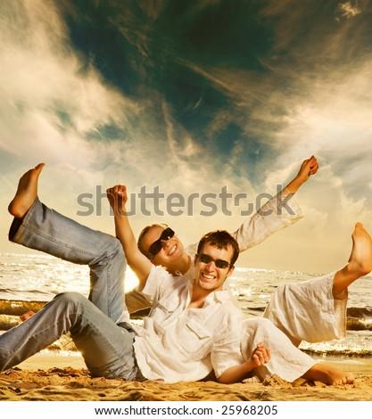 Young beautiful couple having fun on the beach - stock photo