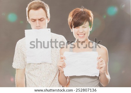 Young Beautiful Couple Holding Cardboard Over Gray Background - stock photo