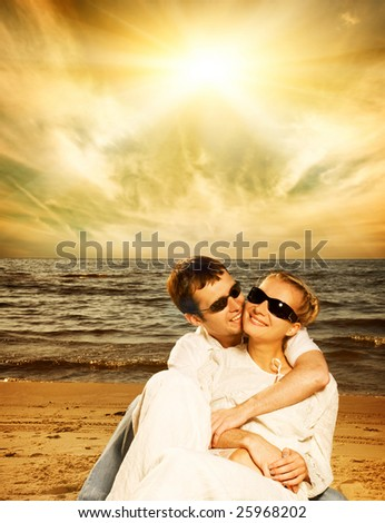 Young beautiful couple in love on the beach