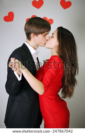 Young beautiful couple in love tenderly kissing  - stock photo