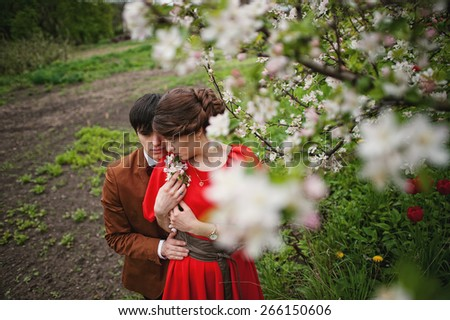Young beautiful couple in the garden