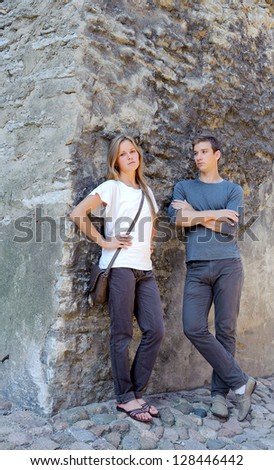 Young beautiful couple in the walls of the old fortress