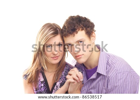 young beautiful couple joining hands - stock photo