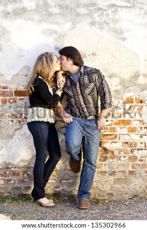 young beautiful couple kissing, room for text - stock photo