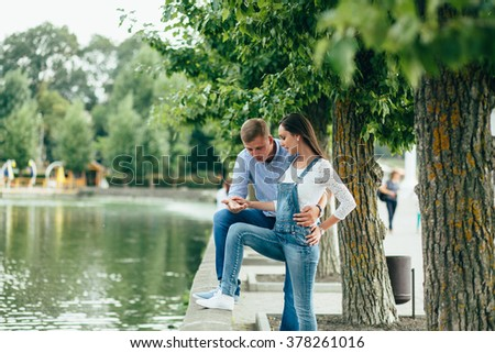 Young beautiful couple near the lake.summer