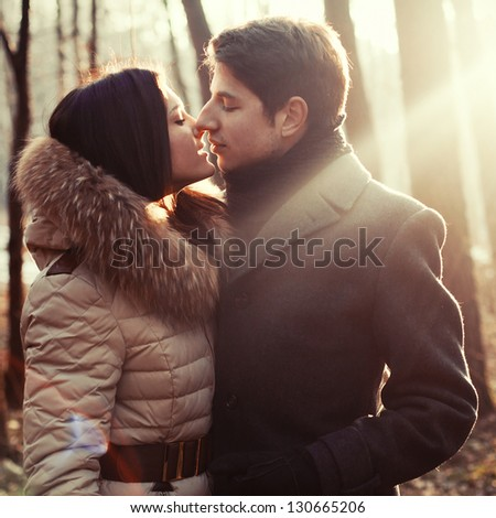 Young beautiful couple outdoor sensual portrait. - stock photo