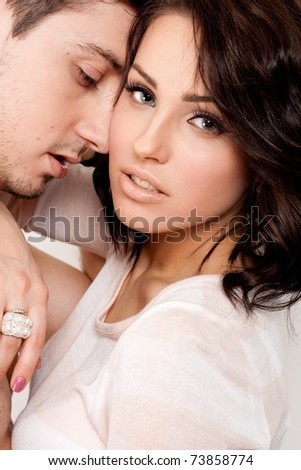 Young beautiful couple posing in the studio - stock photo
