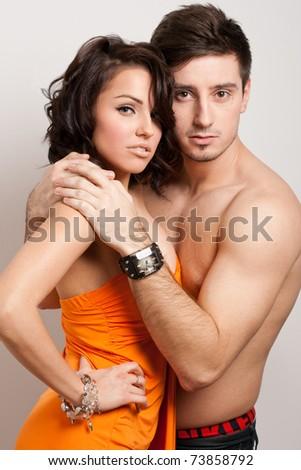 Young beautiful couple posing in the studio - stock photo