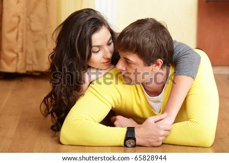 Young beautiful couple tender hugging at home - stock photo