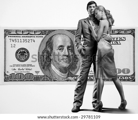 Young beautiful couple under money - stock photo