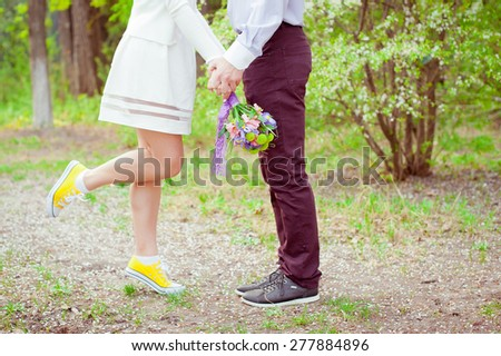 Young beautiful couple with wedding bouquet. Just married. - stock photo