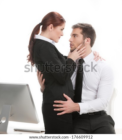 young beautiful coworkers having affair. handsome man touching his colleague at work - stock photo
