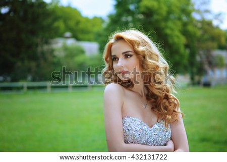 young beautiful curly blonde hair slim girl fashion portrait in white dress posing looking away calm look, in background green grass meadow. Healthy woman lifestyle concept. - stock photo