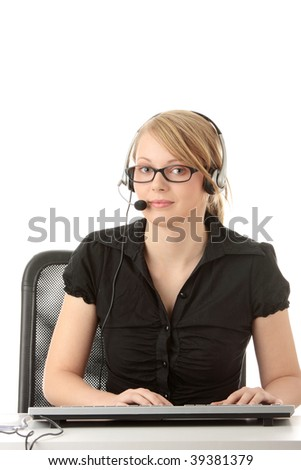 Young beautiful customer service operator girl in headset ,sitting at the desk, isolated on white background. - stock photo