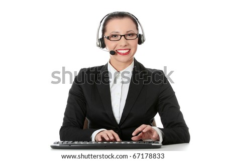 Young beautiful customer service operator girl in headset ,sitting at the desk,isolated on white background. - stock photo