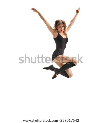 young beautiful dancer jumps on a white studio background