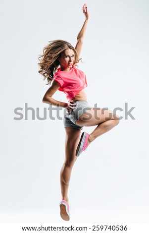 young beautiful dancer posing in studio - stock photo