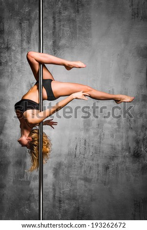 young beautiful dancer posing on studio background - stock photo