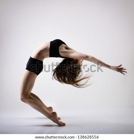 young beautiful dancer teen girl dancing and jumping, studio series - stock photo
