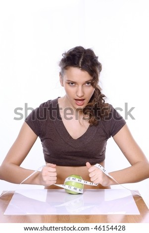 Young beautiful dietician offering apple - stock photo