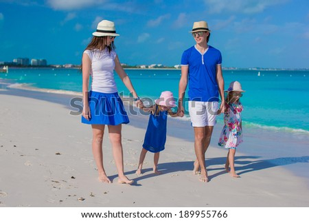 Young beautiful family with two kids on caribbean vacation