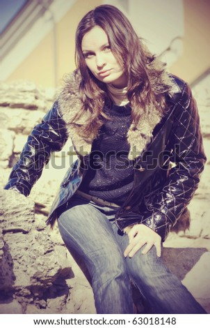Young beautiful fashionable woman posing outdoor